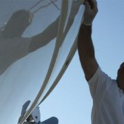 Applying Glidecoat ceramic coating to the hull of a 1998 52′ Princess