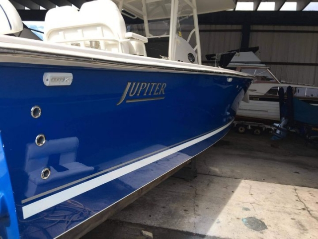 Starboard of blue hulled Jupiter after Glidecoat professional boat detailing and ceramic coating application