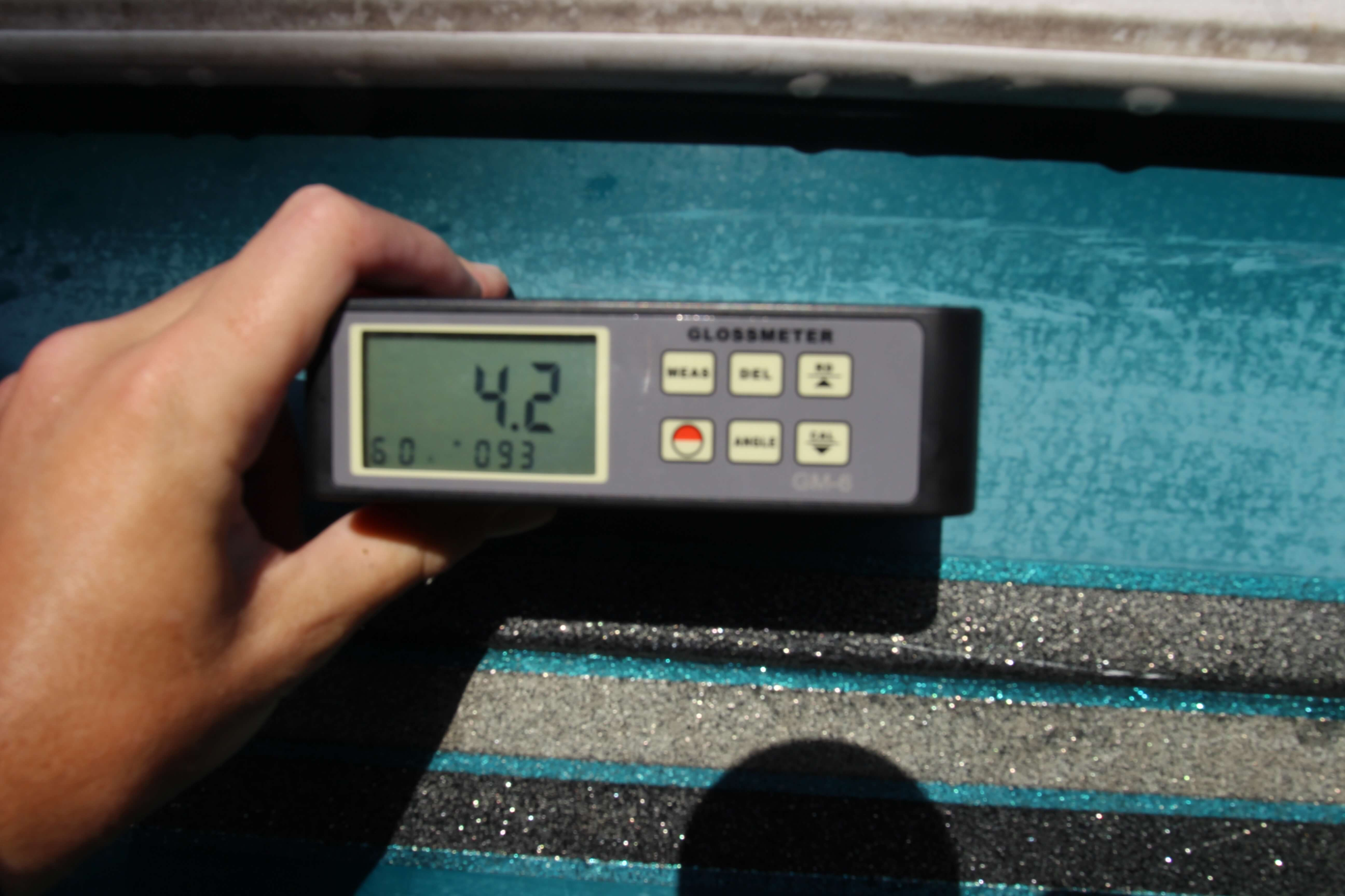 4.2 gloss meter reading on green hulled boat