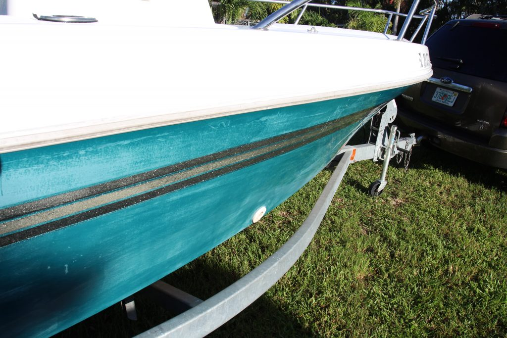 Highly oxidized and faded green color on Ranger boat