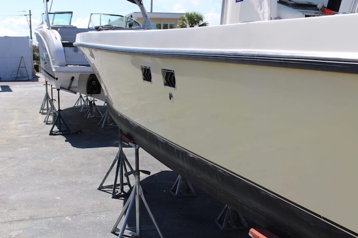 Yellow hull 29 foot SeaVee with restored original shine and color after Glidecoat ceramic coating application