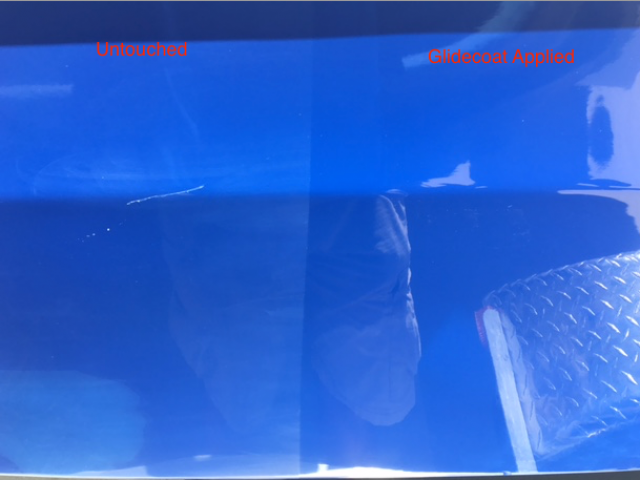 Untouched vs section with Glidecoat applied onto blue hulled boat