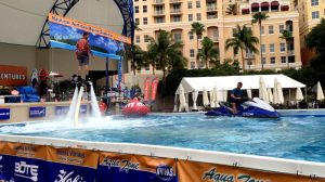 Two men in giant AquaZone at the Palm Beach International Boat Show