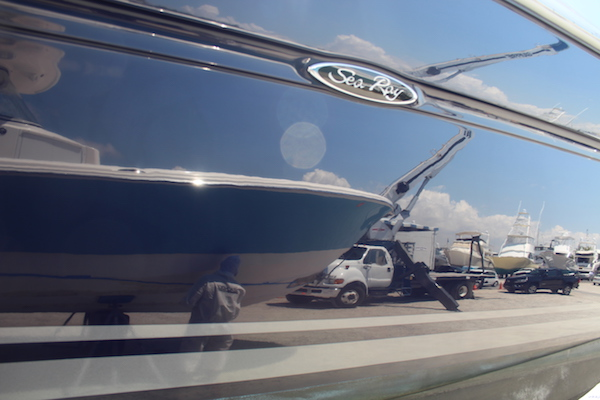 The starboard of blue hulled Sea Ray Sundancer with beautiful shine