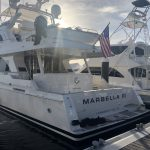 Port side and transom of docked Marbella III