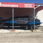 Black and blue MasterCraft X23 Sitting Outside Displaying Hull With Glidecoat Ceramic Coating Applied