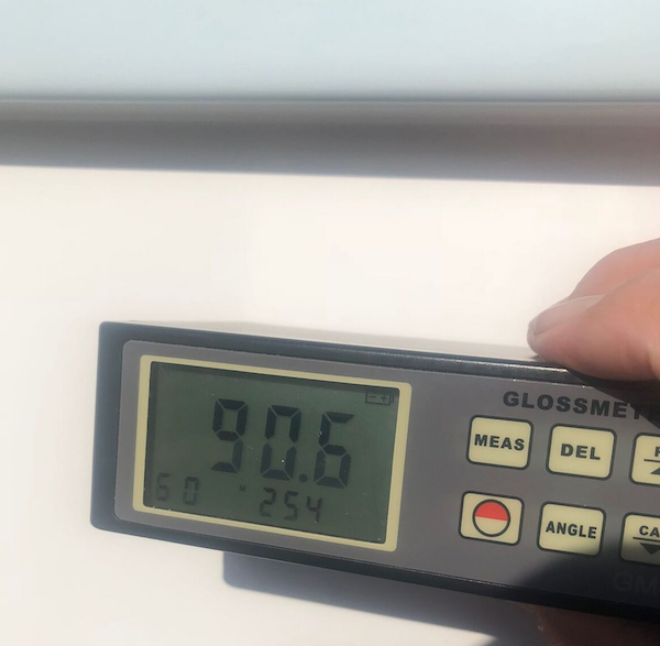 90.6 gloss meter reading on the hull of a brand new 31 Prowler with Glidecoat ceramic coating application