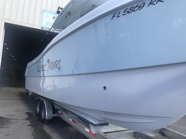 Starboard of 31' Prowler sitting on a trailer at the manufacturers facility