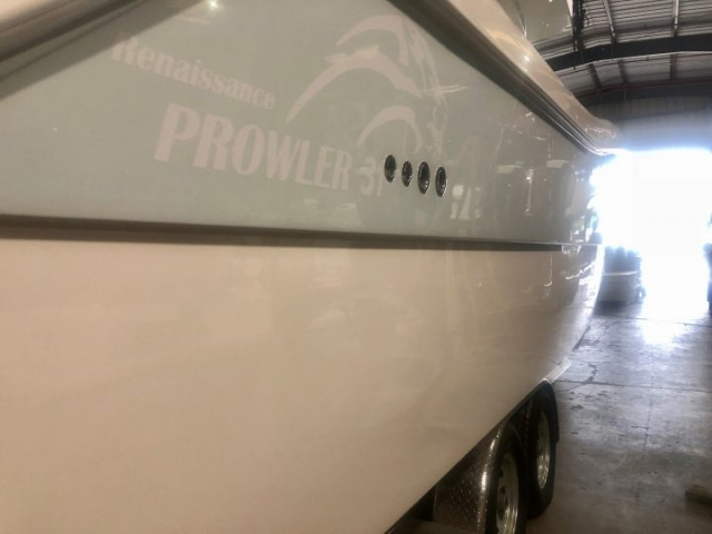 Starboard side of Prowler 31 Hull after Glidecoat ceramic coating application