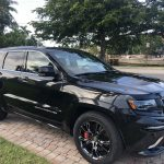 Black Grand Cherokee in the driveway after Glidecoat Automotive Ceramic Coating Application