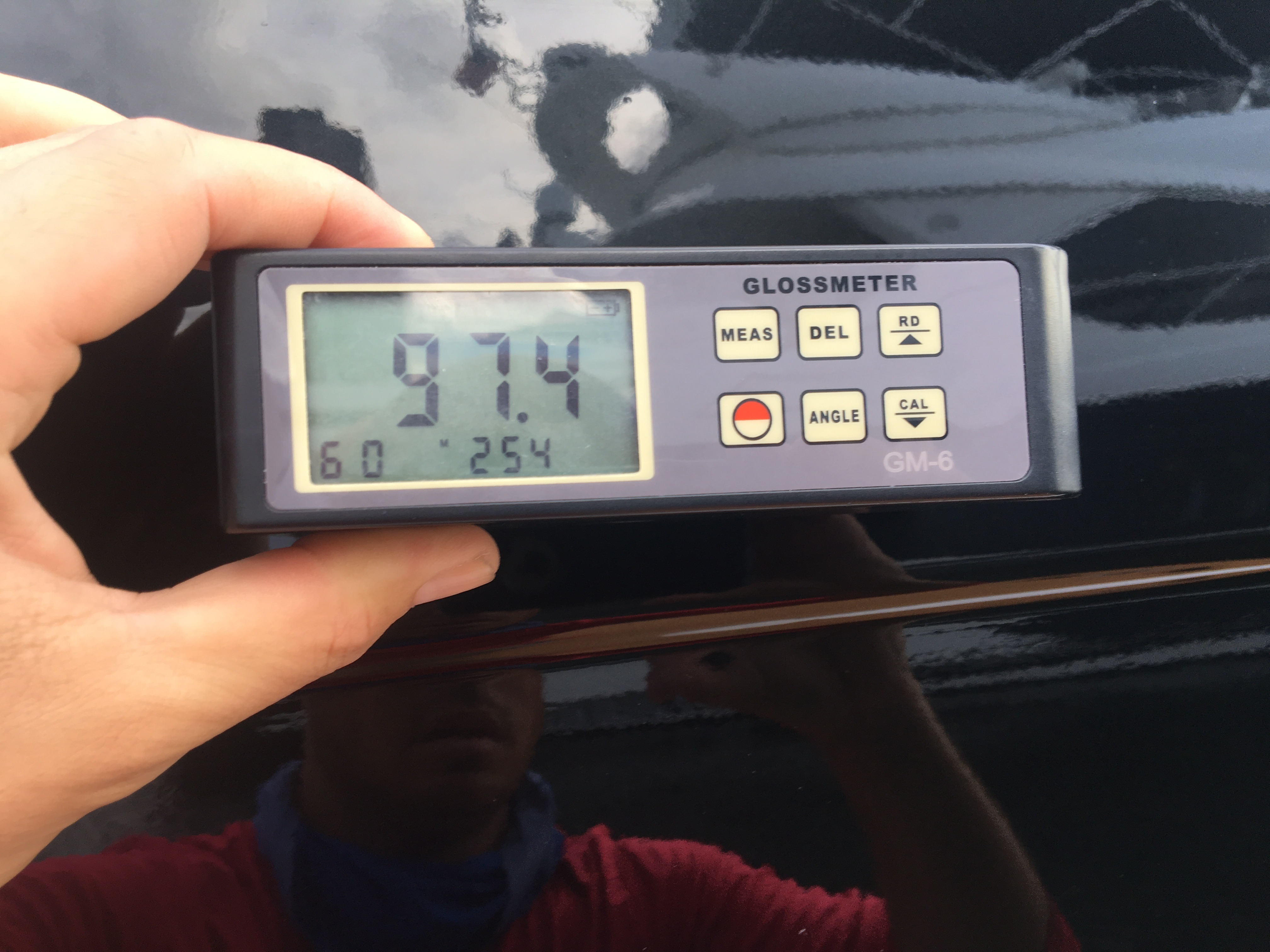 97.4 gloss meter reading on black hull of 66' Azimut