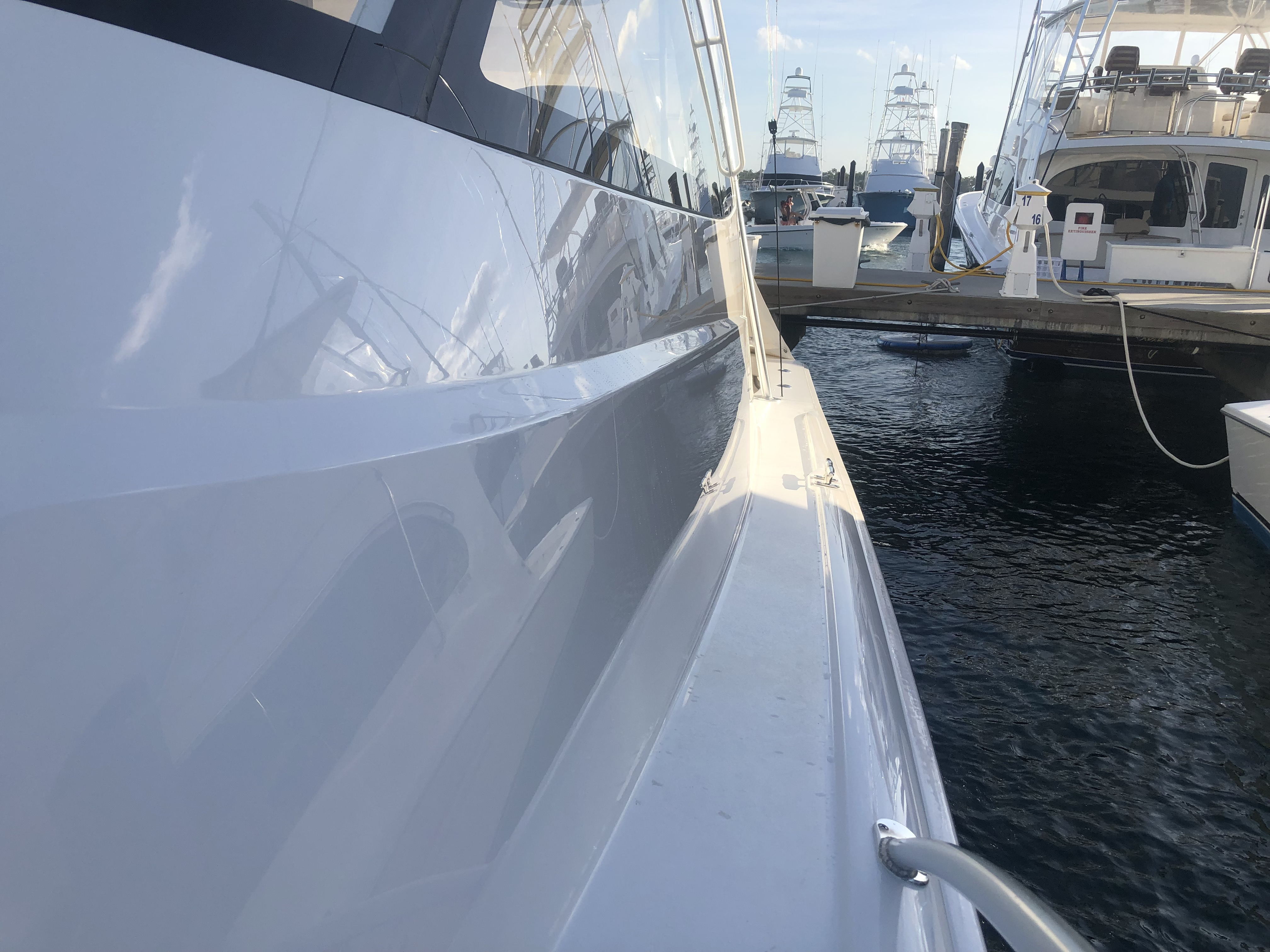 Port side of 52' Viking docked at marina after Glidecoat yacht ceramic coating protection application