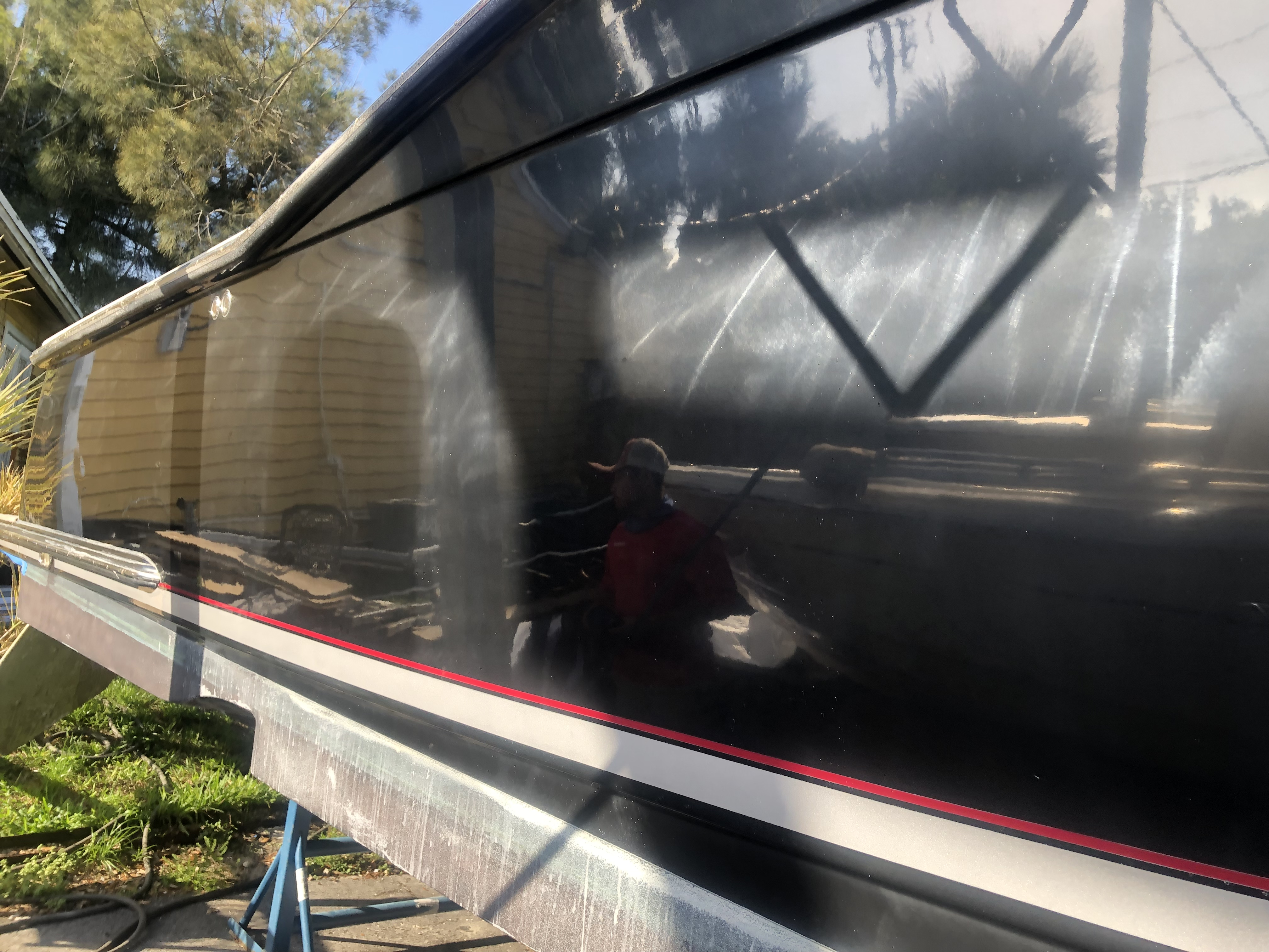 Oxidization on the black hull 35 Scout before Glidecoat ceramic coating application